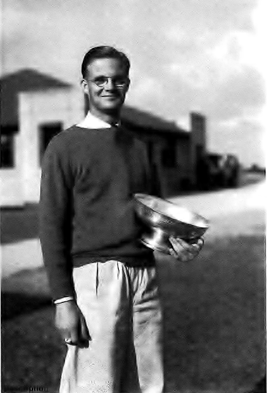 "M. Pierpont ""Pipie"" Warner, winner of the 1932 North and South Amateur, is photographed with his silver bowl trophy at Pinehurst."