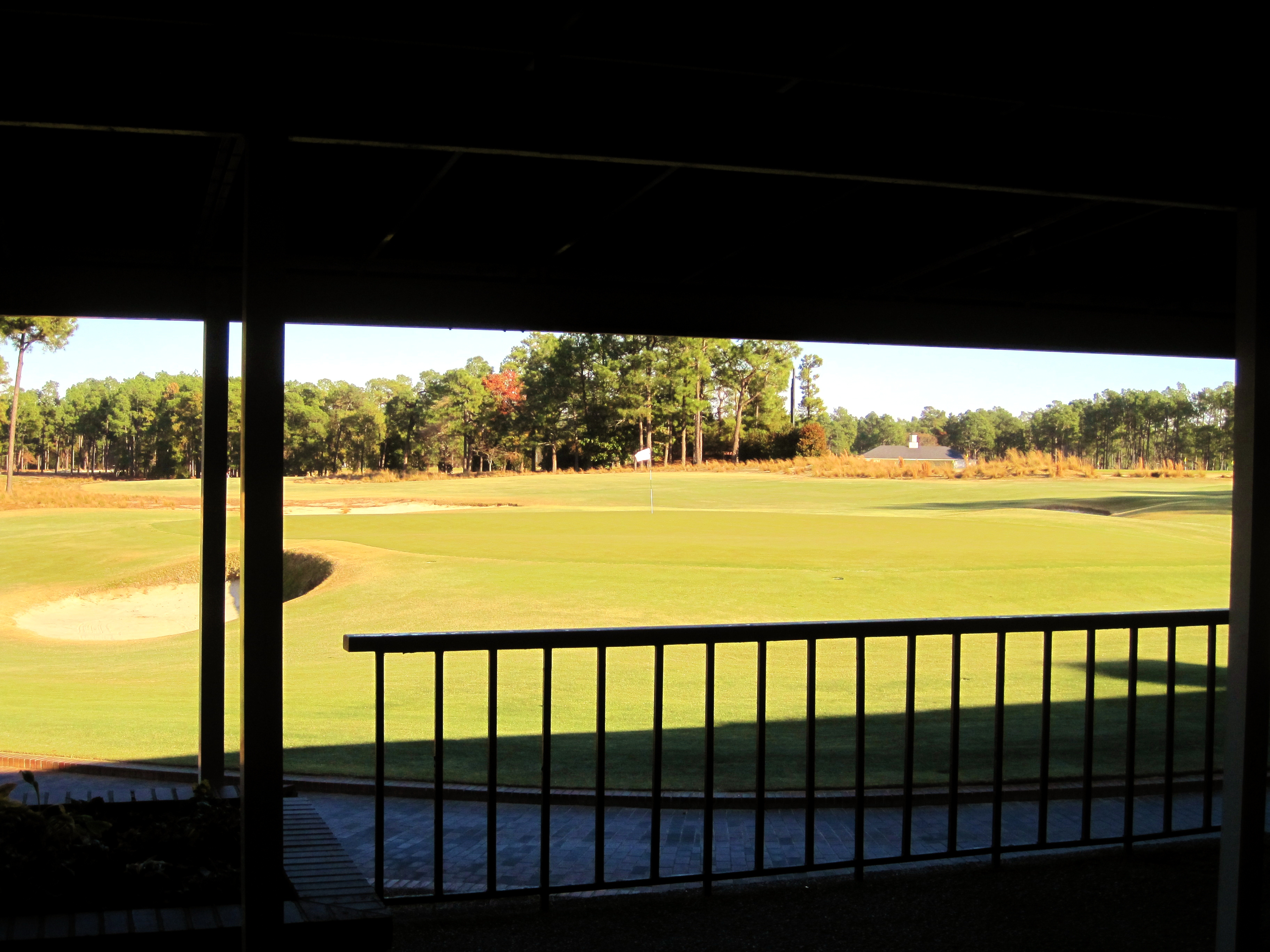View of the 18th green of Pinehurst No. 2 from the East Veranda, with the green awning still in place.