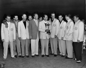 Skip Alexander, standing to the immediate right of United States team captain Sam Snead (holding trophy) survived a plane crash to play at Pinehurst.