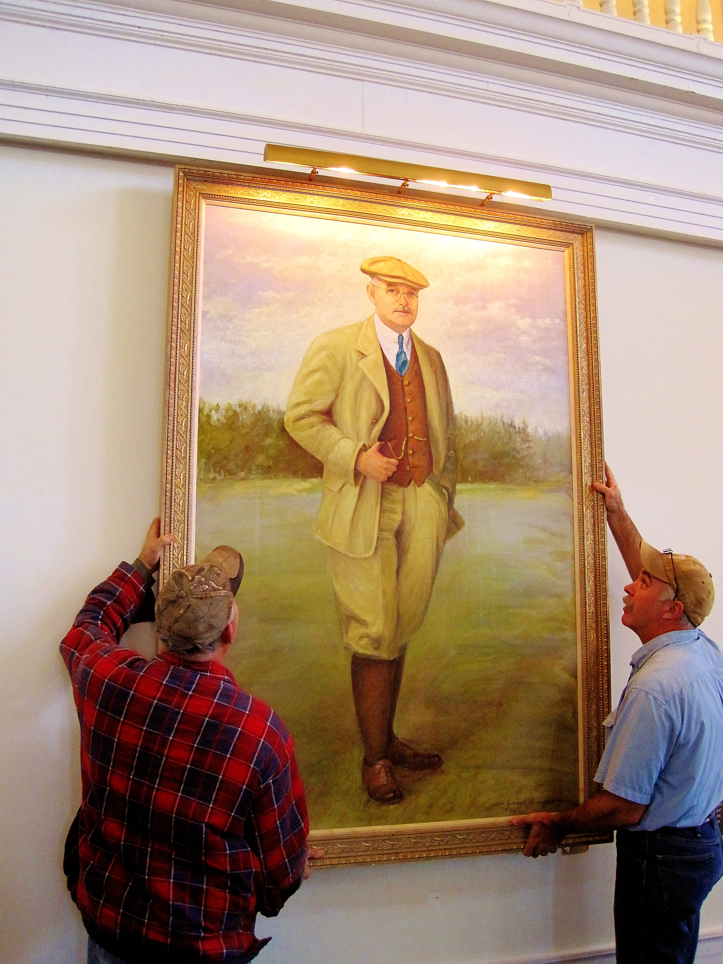 The Donald Ross portrait that adorns the wall of the Pinehurst restaurant that bears his name is removed for restoration.