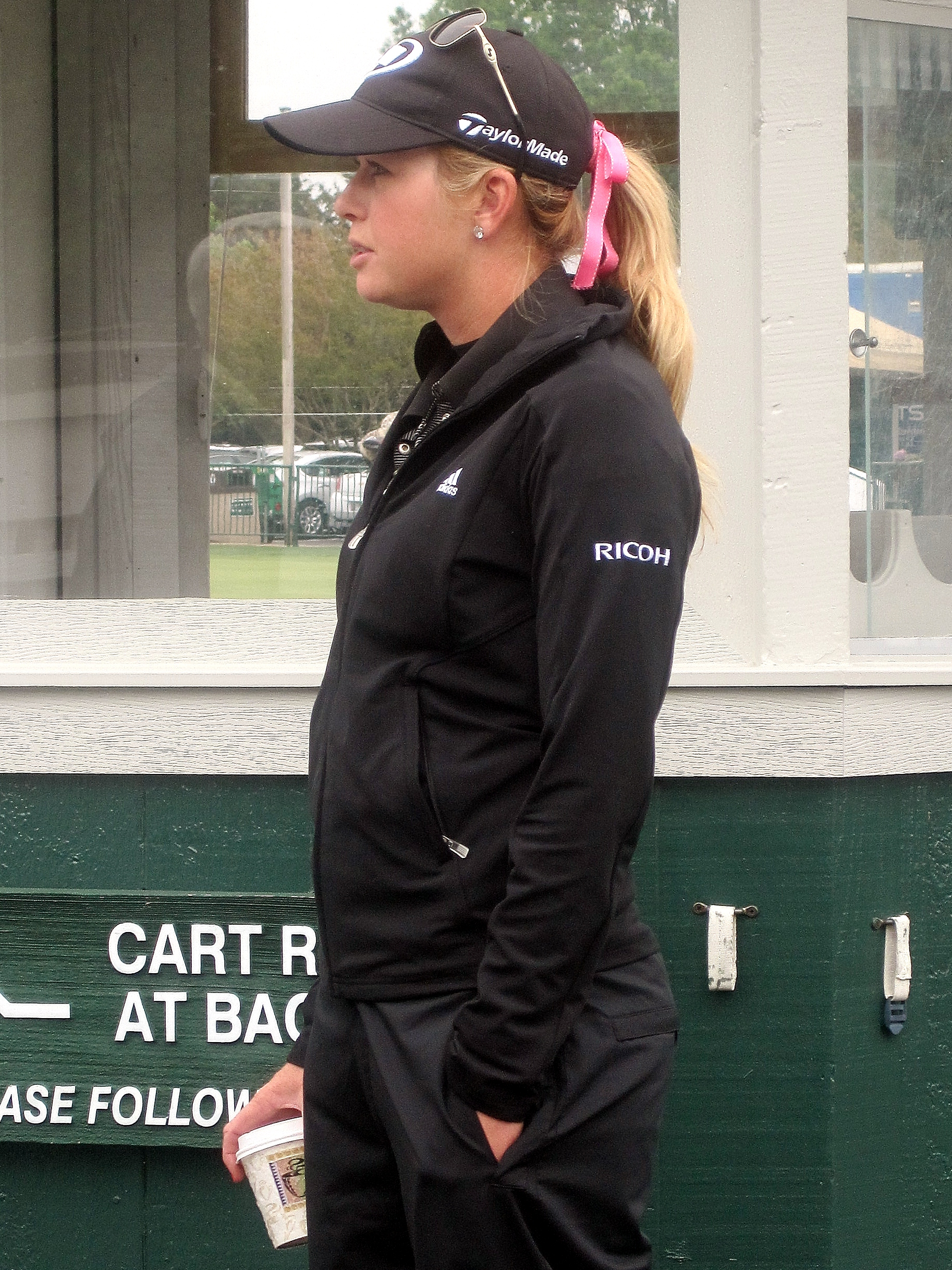 Paula Creamer arrives at the Kingsmill's practice green, much to the delight of the fans.