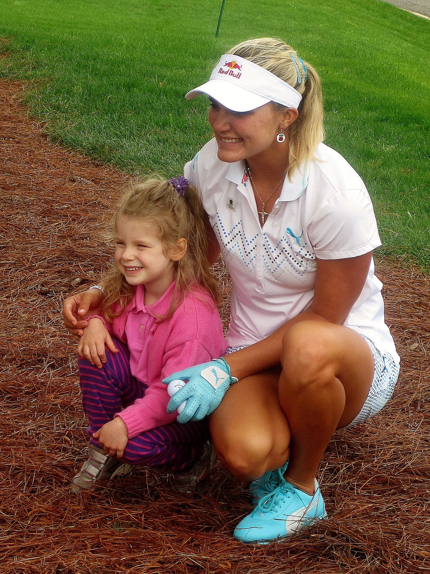 Lexi Thompson takes some time to visit with a young fan.