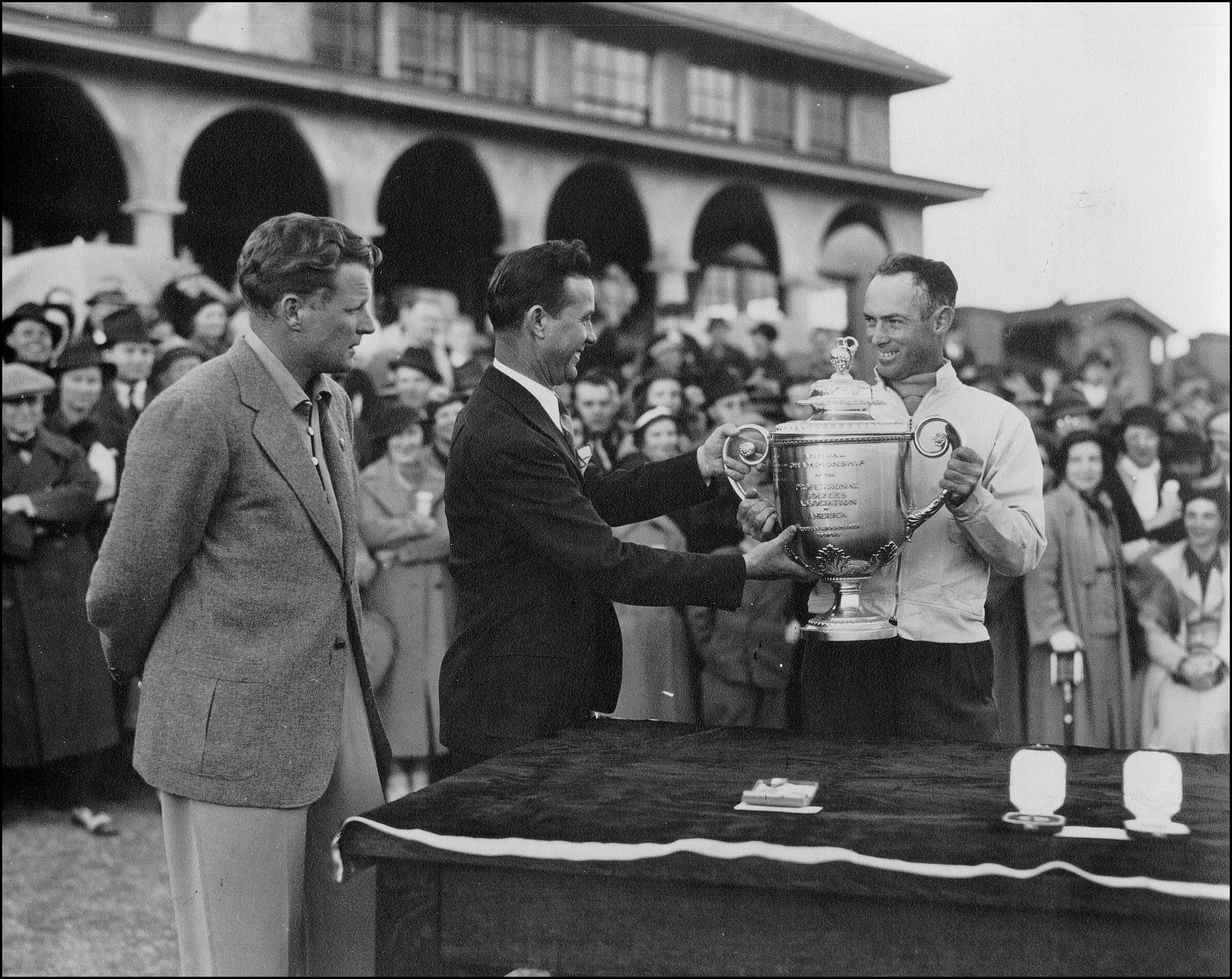 Denny Shute receives the Wanamaker Trophy for winning the 1936 PGA Championship at Pinehurst.
